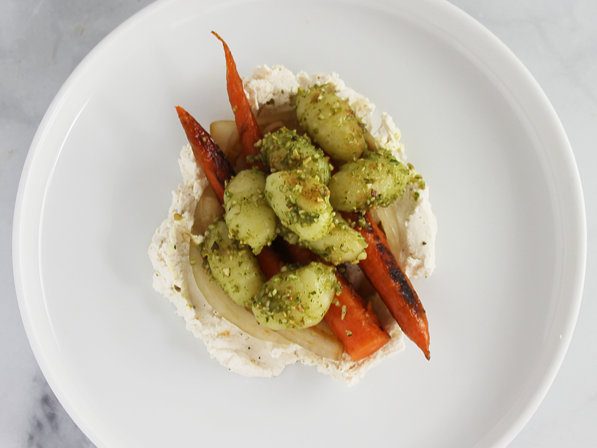 Pan Roasted Carrots with Caramelized Onions, Gnocchi, Herb Pesto and Whipped Ricotta